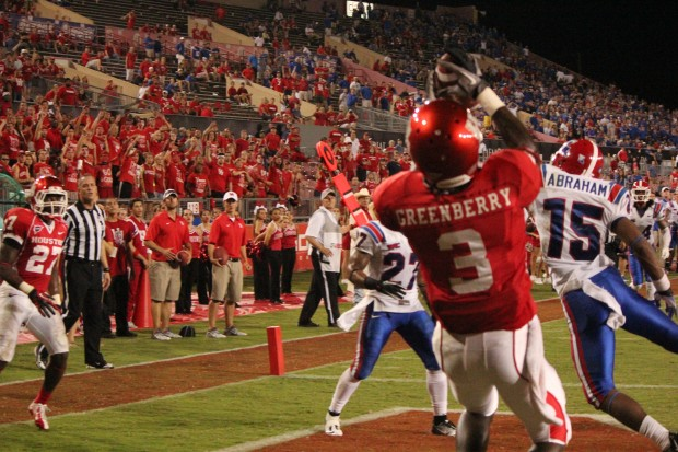 True freshman Deontay Greenberry catches his first collegiate touchdown pass in traffic defenders against Louisiana Tech. | Hendrick Rosemond/ The Daily Cougar