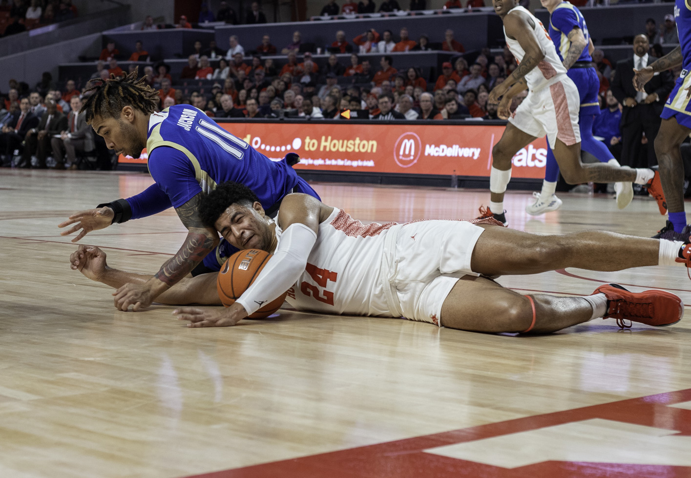 Sophomore guard Quentin Grimes went down hard on his pelvis in Houston's 76-43 win over Tulsa on Wednesday night at Fertitta Center, keeping him out for the rest of the game with a hip pointer. | Katrina Martinez/The Cougar
