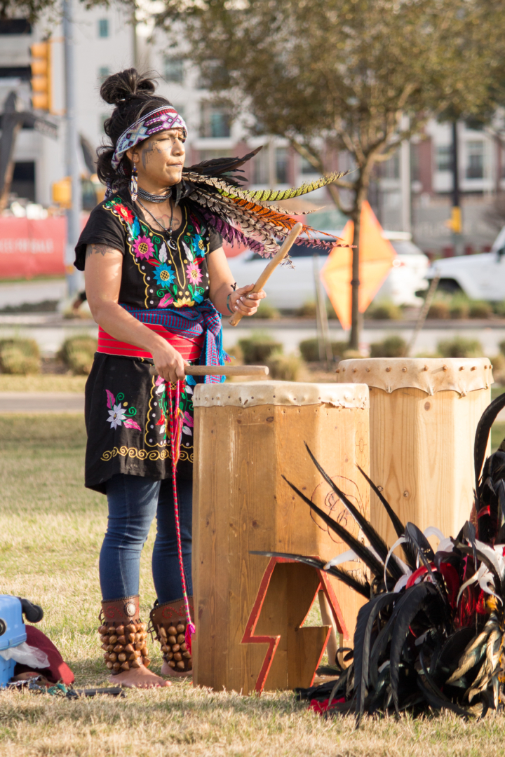 Abuela M'api leads the Houston Aztec Dance group in their traditional dance by playing the drums. As a way to spread her culture she teaches free Aztec dance classes at Moody Park. | Katrina Martinez/The Cougar