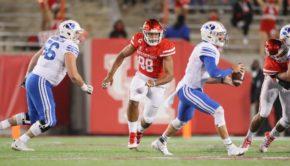 One of the leading stars in Houston's defense, senior lineman Payton Turner pursues BYU junior quarterback Zach Wilson.   Courtesy of UH athletics
