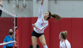 UH volleyball sophomore middle blocker extends high for the ball in a game against Rice during the 2020-21 season. | Courtesy of UH athletics