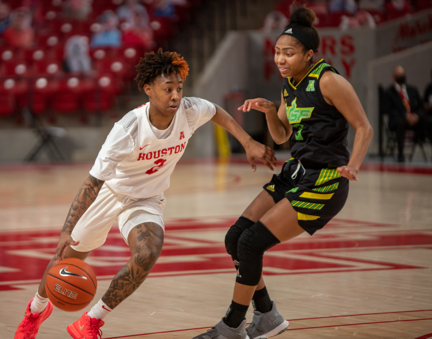 UH women's basketball guard Miya Crump (2) drives past a USF defender on Feb. 27 inside of Fertitta Center. Crump tied an AAC-record with six steals on Tuesday during the UH women's basketball team's game against ECU. | Andy Yanez/The Cougar