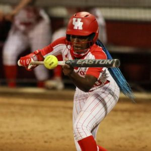 UH softball redshirt senior outfielder Lindsey Stewart-Vaughn makes contact with the ball during a late evening contest in the 2021 season. | Courtesy of UH athletics