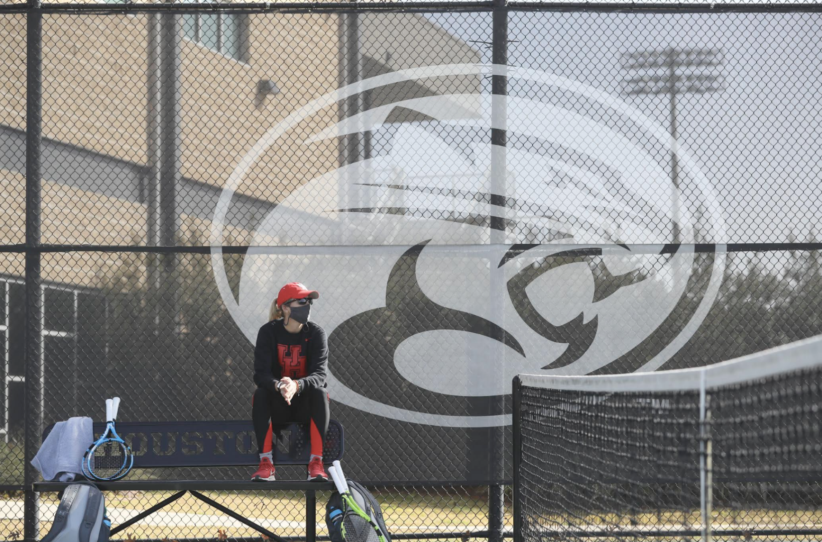UH tennis head coach Helena Besovic watches on as her team practices at the Winston Tennis Facility. Besovic, who grew up in Sarajevo, Bosnia-Herzegovina, still uses the lessons she learned during and after the Bosnian War in her life.   Courtesy of UH athletics