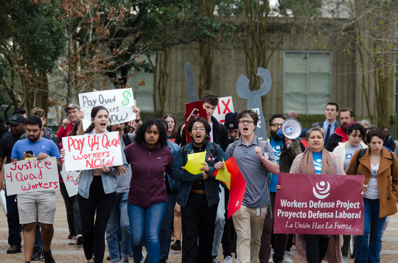 Workers, students and professors gather to protest on campus for unpaid wages that eight construction workers have filed a complaint about. The workers report not being paid at least $43,000 from 2019 while working on the Quad Replacement project. | Lino Sandil/The Cougar