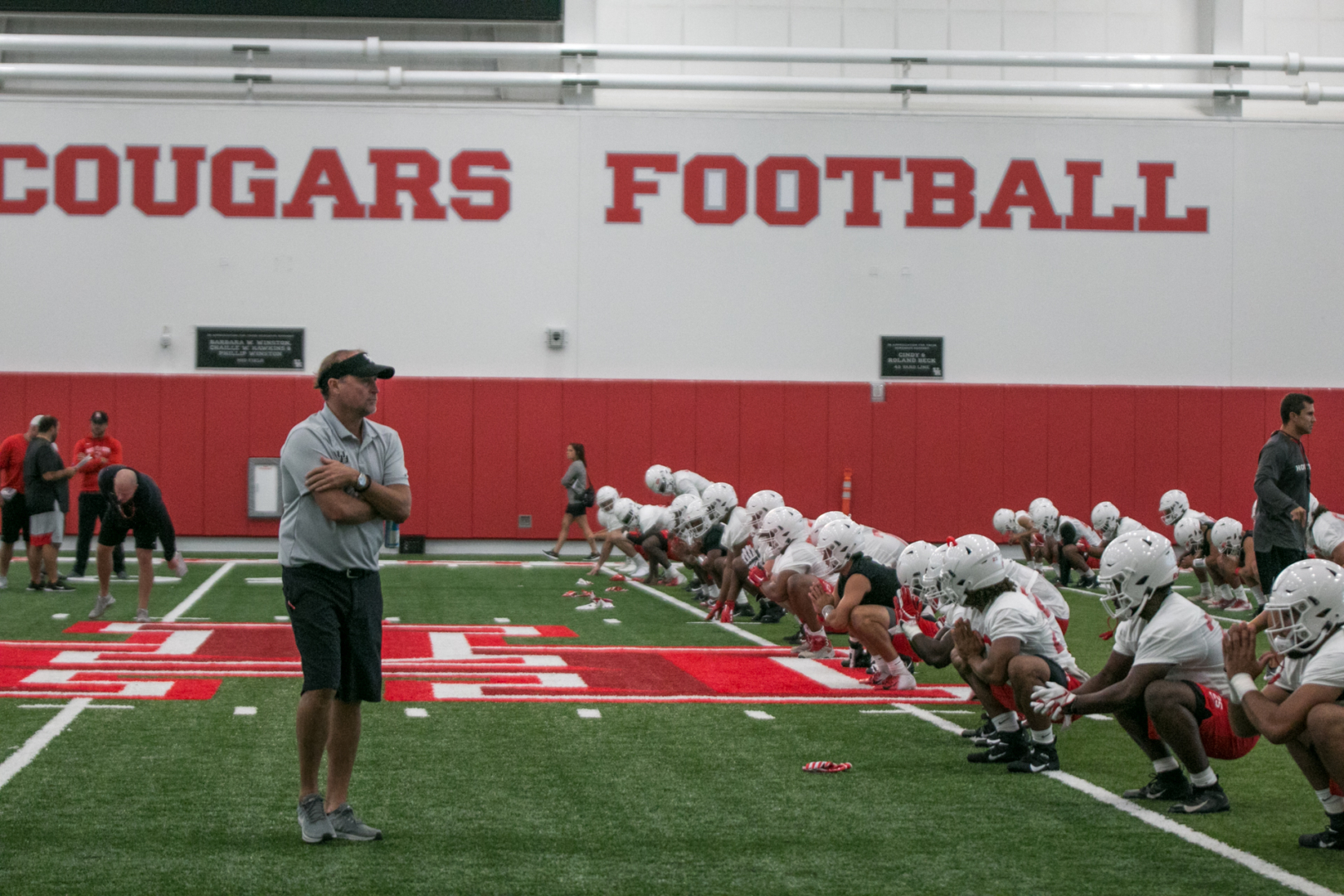 UH head coach Dana Holgorsen looking over his team during last season's training camp practice. | Kathryn Lenihan/The Cougar