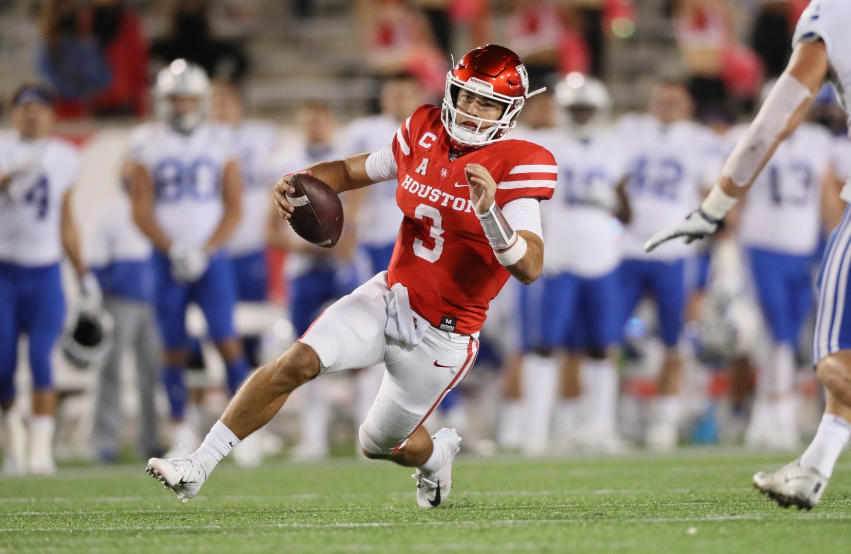 UH junior quarterback begins his slide after a rush against BYU during last Friday's game at TDECU Stadium. Houston lost 43-26 after BYU took complete control of the contest in the final period. | Courtesy of UH athletics