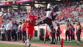 Cincinnati receiver Blue Smith skies over Houston cornerback Marcus Jones for the score at TDECU Stadium during the 2019 season. | Trevor Nolley/The Cougar