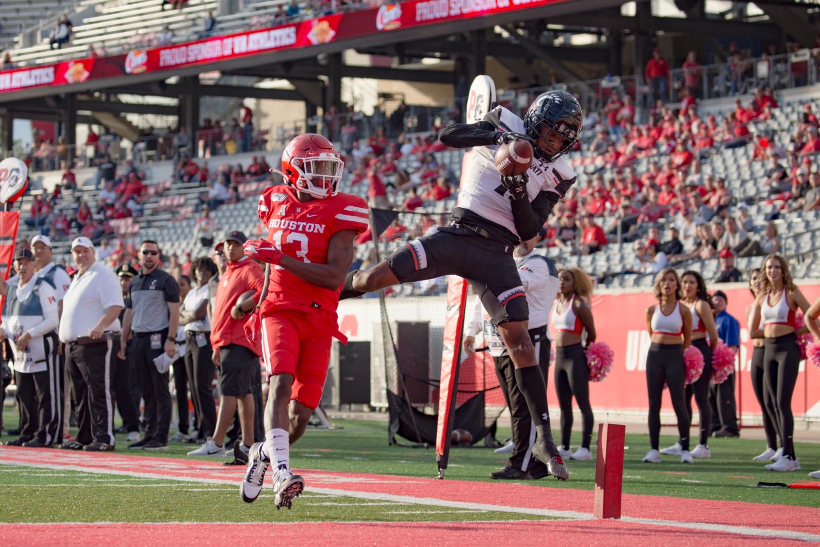 Cincinnati receiver Blue Smith skies over Houston cornerback Marcus Jones for the score at TDECU Stadium in an AAC battle during the 2019 season. | Trevor Nolley/The Cougar