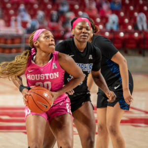 UH junior forward Tatyana Hill (30) drives to the basket against Memphis on Feb. 13 at the Fertitta Center. Hill led the team with 15 points and nine rebounds. | Andy Yanez/The Cougar