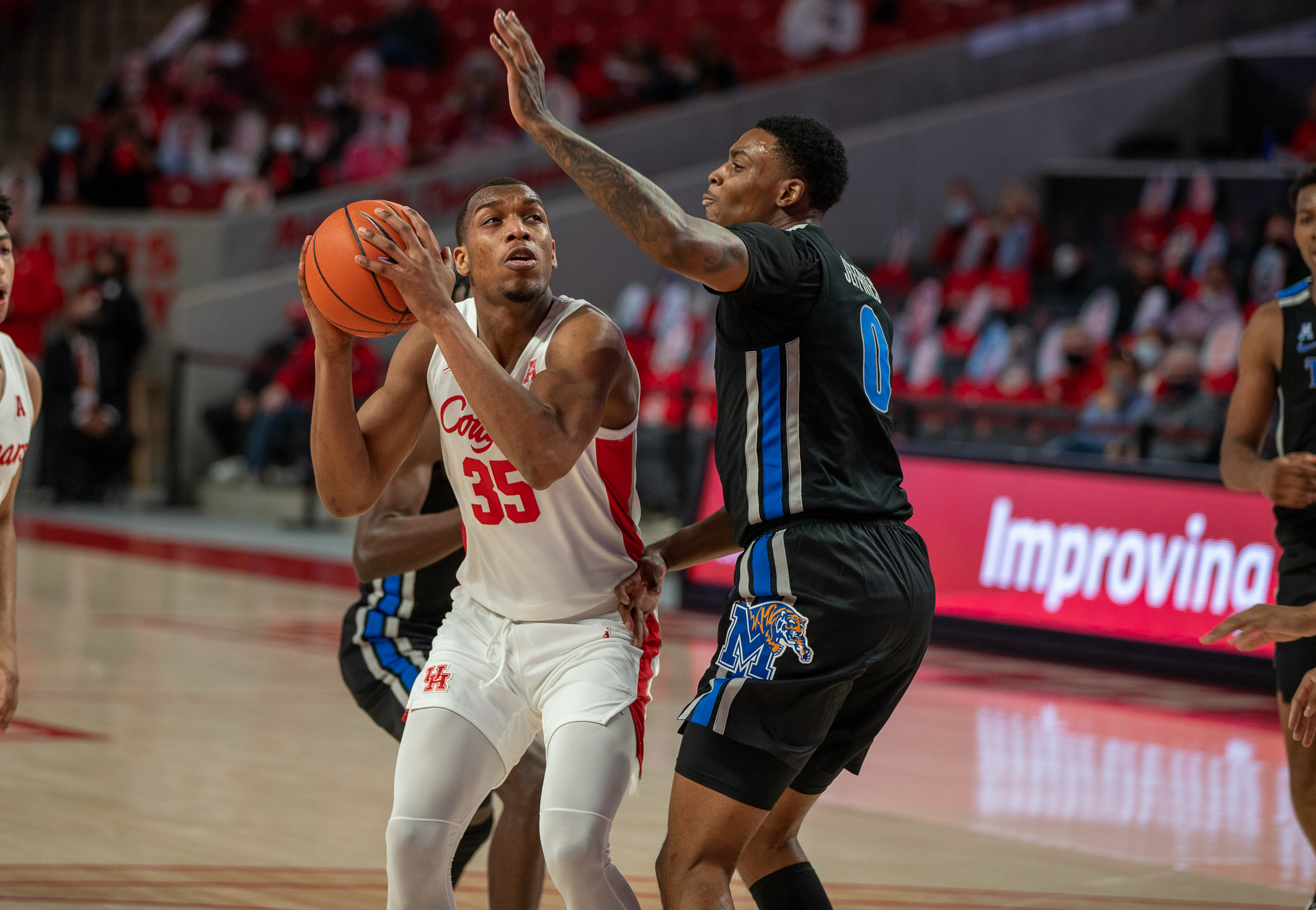 UH forward Fabian White Jr. goes up through the contact during last Sunday's game against Memphis at Fertitta Center. | Andy Yanez/The Cougar